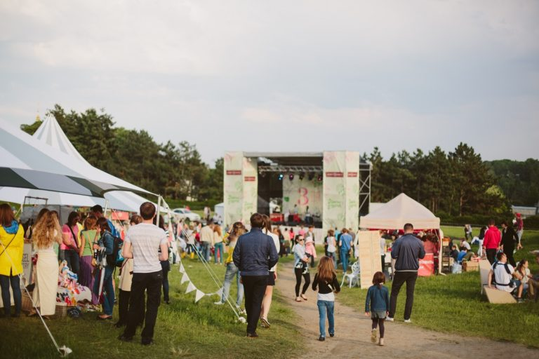people gathered in a music festival