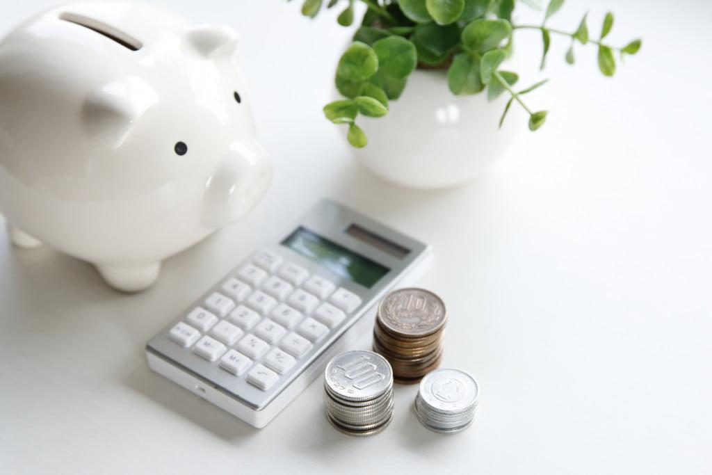 Piggybank with calculator and coins