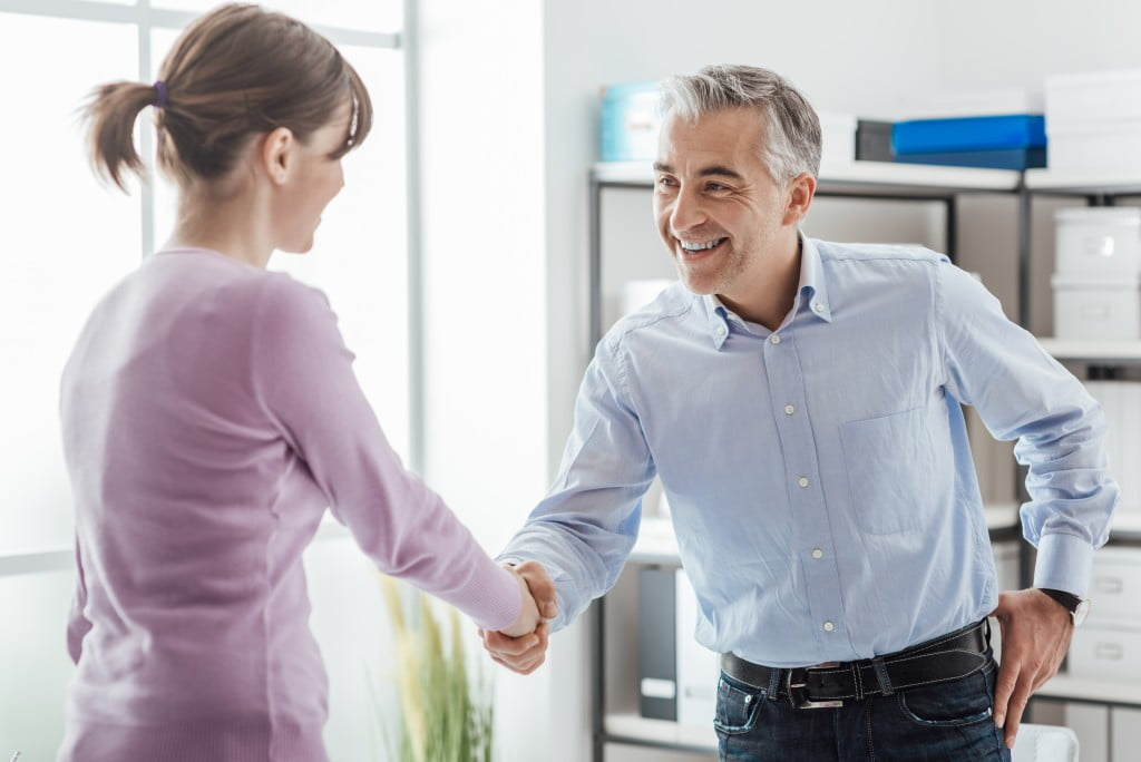 Employer and candidate shaking hands