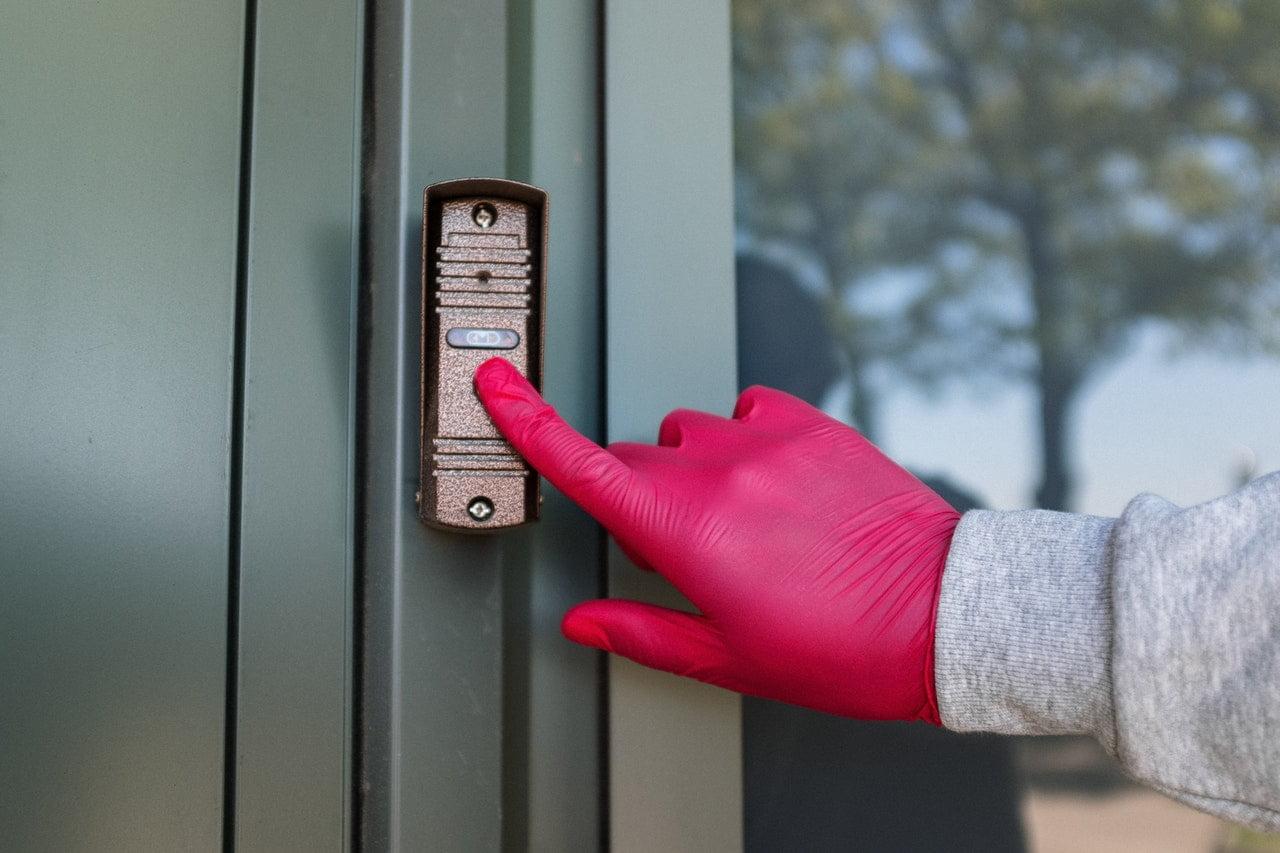 door bell wearing gloves
